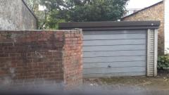 Spacious Garage With Small Plot Of Land Attached