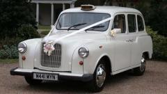 Hire Classic White London Taxi Wedding Car